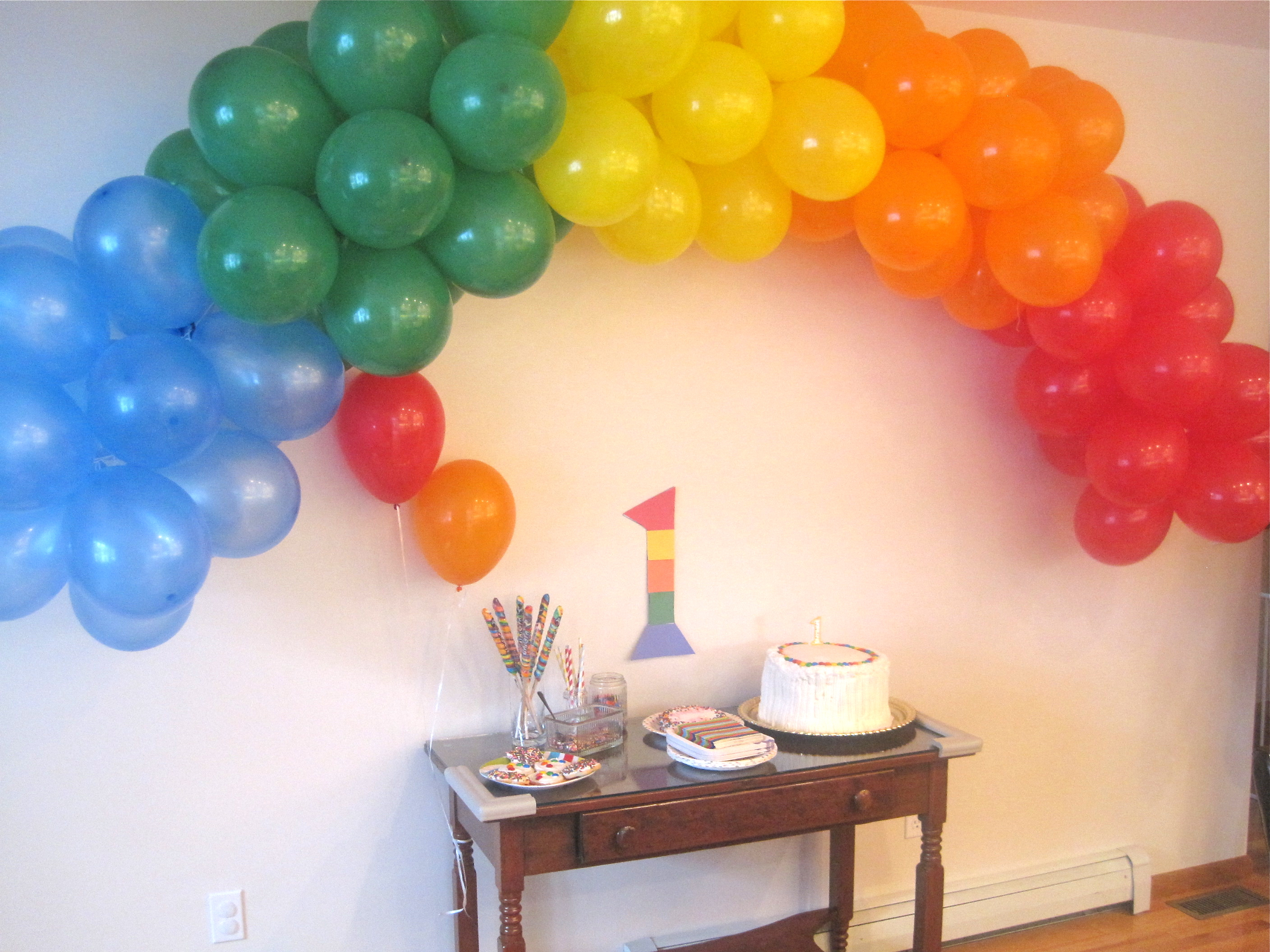 A colorful 1st birthday party rainbow party theme hip for Balloon decoration for 1st birthday